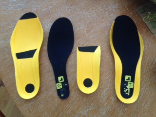 The black insole sits atop the foam, optional inserts.