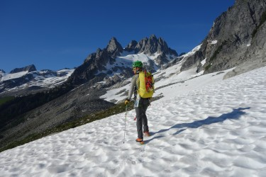 Mike Arnold, IFMGA/AMGA mountain guide, approaching the West Arete of Eldorado Peak, in the Cascades